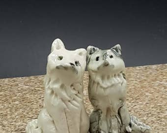 Miniature wolf pair -  porcelain sculpture