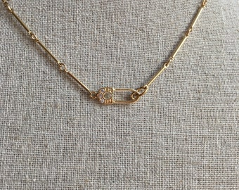 Tiny gold Safety Pin Necklace