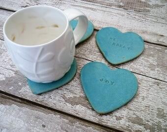 Handmade, Ceramic coasters, bespoke Loveheart coasters.  Tea light stands