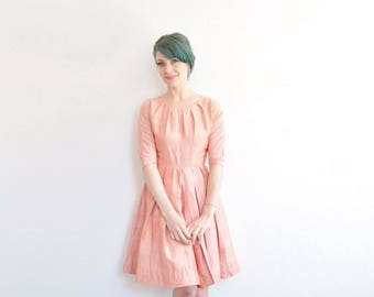 1950 pastel coral spun silk dress . pleated collar . full skirt . salmon pink .extra small.xs