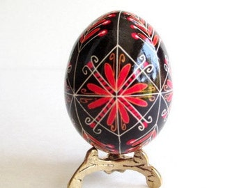 Hristos Voskrese Ukrainian Easter egg decorated with hot beeswax Eastern European orthodox church traditional egg for blasing of the basket