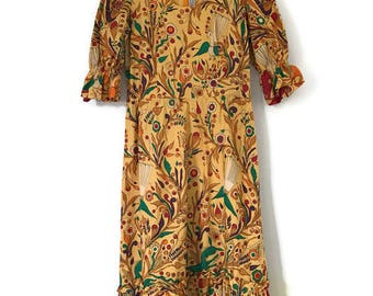 vintage 1960s or 1970s yellow batik print mod midi dress with puffed sleeves, scoop neck, gathered waist / xs small / cotton