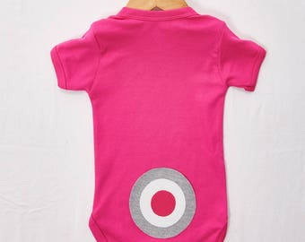 Hand Sew Grey and Pink Target on the bottom of a pink babygrow