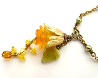 Yellow flower pendant necklace - crystal dangles, antiqued gold, green pearl chain, layered lucite, gold tulip bead cap. Floral bead jewelry