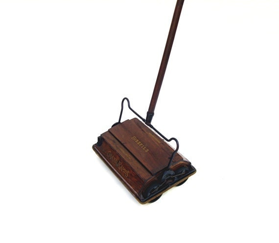 vine vacuum bissell s advertising oak grand rapids carpet rug floor cleaner works looks zoom - Bissell Sweeper