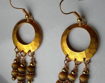 Ayla's Bead Creations Hammered gold cats eye Earrings.