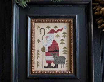 Kringle & Woolard Christmas cross stitch pattern by Plum Street Samplers at thecottageneedle.com Santa Claus sheep ewe
