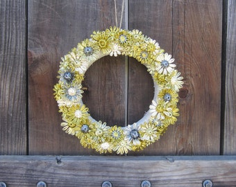 Enid 12 inch linen wrapped wreath with woven shades of golden green, ivory and grey flowers in vintage Swistraw by Ruby Buffalo.