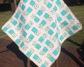 "Aqua, Brown, Pink, Polka Dots and Flowers Altogether In This 41.5"" X 41.5"" Quilt"