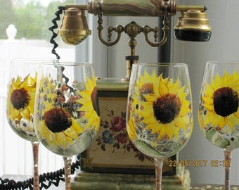 Wine glasses with stems set of four Sunflowers green leaves hand painted throughout the glass. Also one sunflower painted on glass bottom