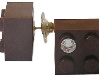 Brown LEGO (R) brick 2x2 with a Diamond color SWAROVSKI crystal on a Silver/Gold plated stud