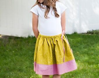 Girls twirly chartreuse green yellow skirt, pink bottom panel, tie waist, sizes 6 m to 12 drawstring