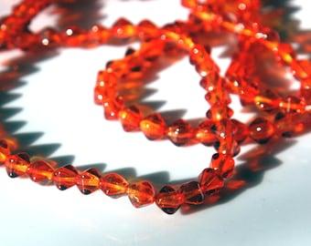 Czech glass x 75, Orange-Topaz, 6mm bicone, pressed beads