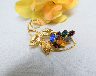 Multi Color Rhinestone Accented Gold Tone Floral brooch