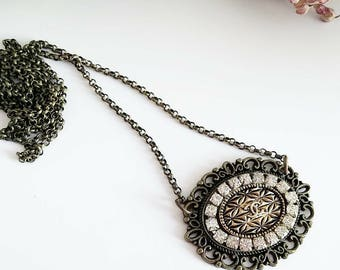 Antiqued necklace with Chanel vintage button and Crystal