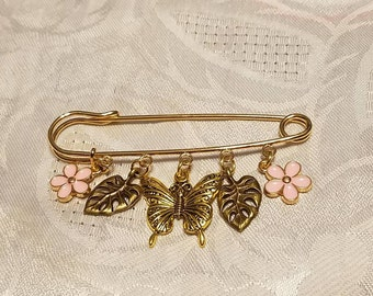 Say happy mothers day with this sweater pin pink flowers and gold butterfly center  charm