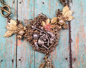 Yee Haw - an assemblage, collaged, fun cowgirl bronc riding, bib necklace
