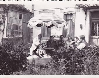 Family In Garden - Girl In Pedal Car - Children - Toy - Courtyard