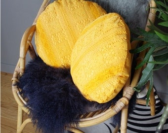 Yellow round cushion with old lace