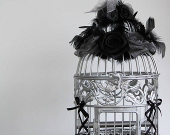 Decorative birdcage adorned with lace and ribbons feathers flowers