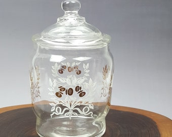 Mid-century design glass jar printed with white leaves and gold berries or nuts small bathroom storage or candy jar