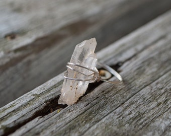 Beautiful baby Lemurian seed Quartz crystal ring, completely handmade from sterling silver wire. It's a US Womens size 5-