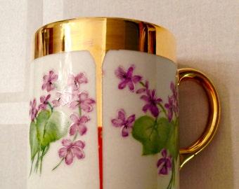 Violets and gold mug
