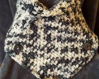 Handmade crochet cowl or neck warmer in black,white and grey yarn with decorative buttons