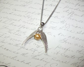 Gold pearl necklace with silver wings