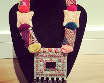 exclusive necklace made with afghan piece with color stones, swaroski stones,beads and pompon,