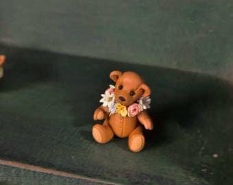 Bear with flower collar