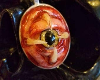 Cat pupil with teeth eye pendant!