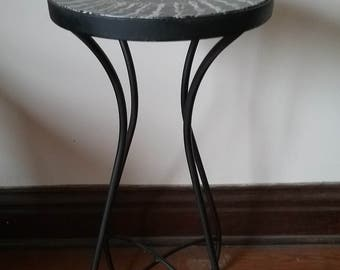 Wrought iron bistro table with vinegar painted glass top