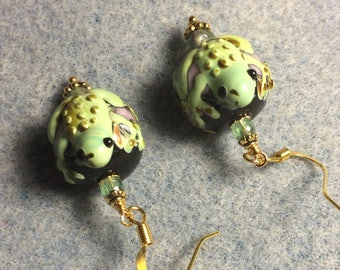 Green lampwork frog bead earrings adorned with green Czech glass beads.