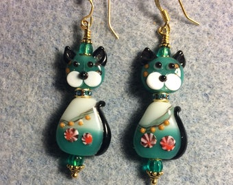 Teal, black and white lampwork cat bead earrings adorned with a rhinestone collar and teal Czech glass beads.