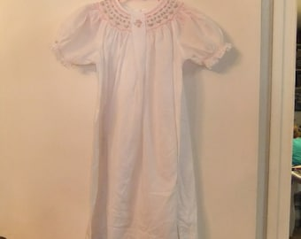 White dress (or gown)  smocked with pink