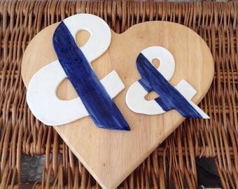 Sign & with blue stripe through