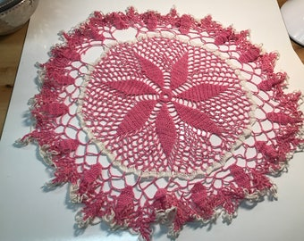 pink and white vintage crocheted doily