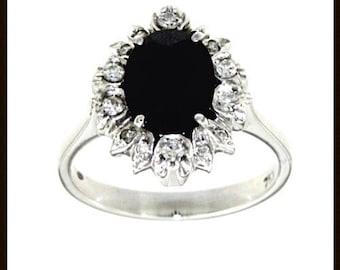 Ring with Central Sapphire and diamond outline