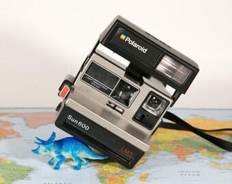 POLAROID LMS Sun 600 Instant Camera #P142
