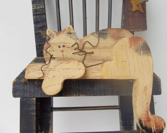Vintage cat in a chair wooden wall hanging.