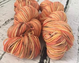 Sock yarn superwash merino, nylon, orange, yellow, black, hand dyed
