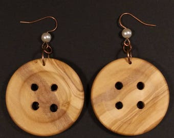 Hand-turned-shaped button earrings in olive wood