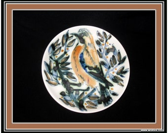 Decorative handpainted porcelain plate marked by Teun R. Dish made of china (chinaware) and decorated with a jay bird painted by hand
