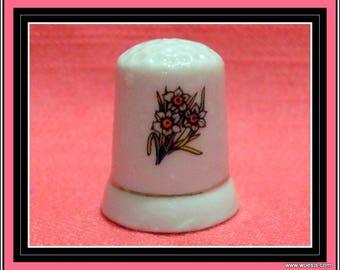 Vintage thimble of white ceramic.