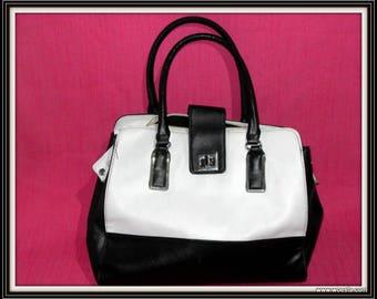 Vintage black and white atmosphere shoulder bag made of leatherette.