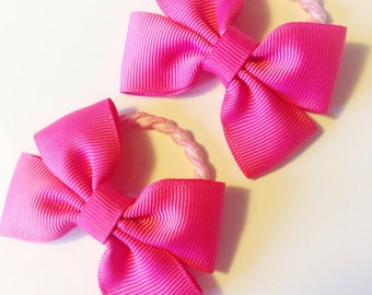 Pair of bright pink hair bobbles - pigtail bobbles