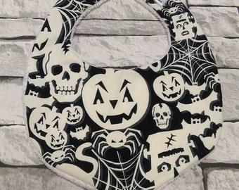 Halloween, glow in the dark print baby bib. One size