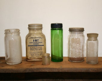 Old bottles; 5 old crusty bottles & 1 extra top; 4 with lids, 1 without; glass bottles; B-7