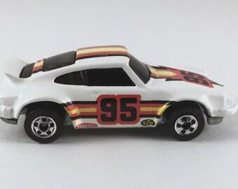 Hot Wheels Die Cast Car, Vintage Porsche, White, 95 Pennzoil STP Car, 1974 Metal Toy, Very Good Condition